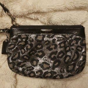 Black and silver animal print Coach wristlet